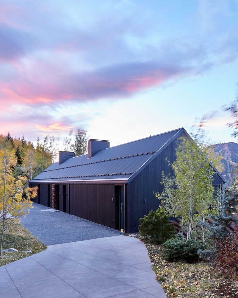 The minimalist wood siding and gable roof give the Art Barn a modest and mysterious appearance