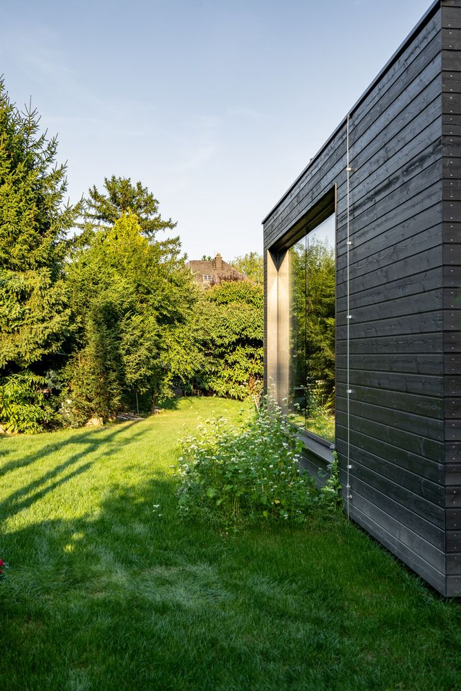 There's greenery all around the annexes and around the original house which adds continuity to the project