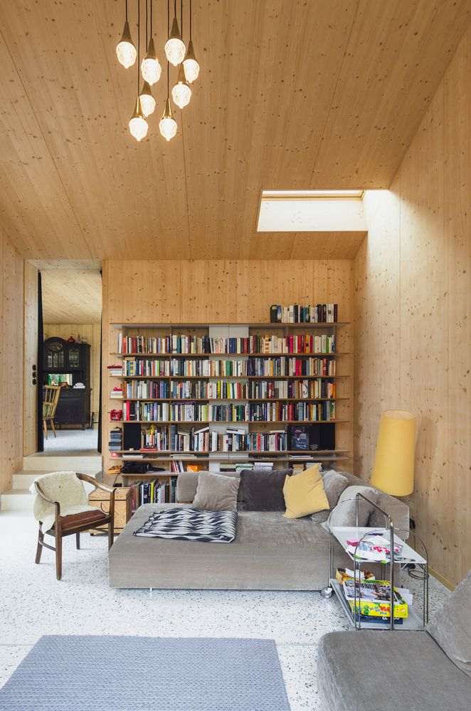One of the newly added areas is this cozy living space with a skylight, bookshelves and a sofa