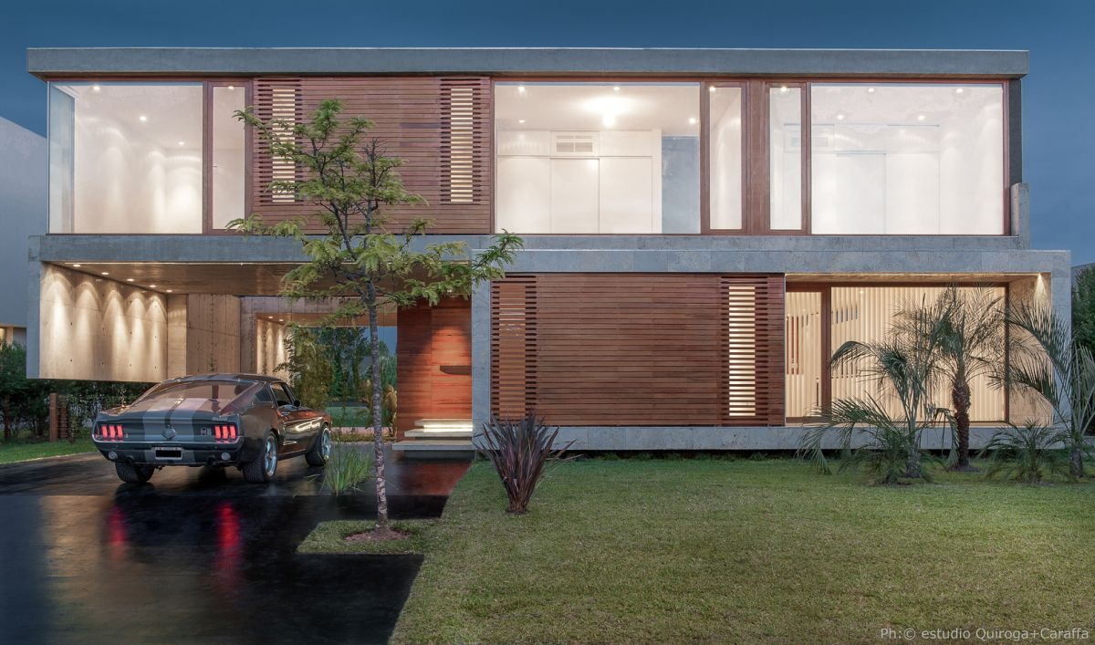 Wooden panels on the front facade block out certain areas, offering privacy to some of the spaces