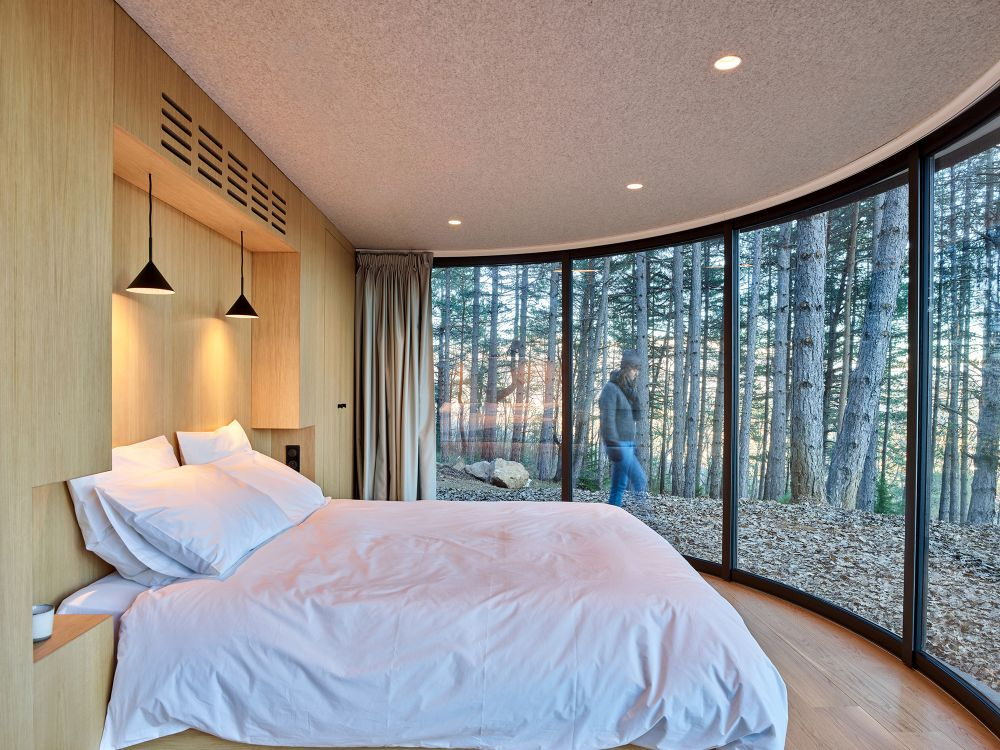 The curved window is meant to connect the pod with nature and to allow in a panoramic view of the immediate surroundings