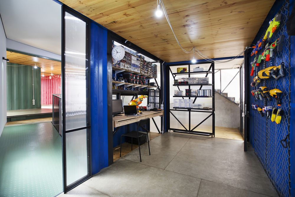 Indonesia Container for Urban Living Atelier Riri craft space - Industrial Family Home Made From Shipping Containers And Reclaimed Pallets