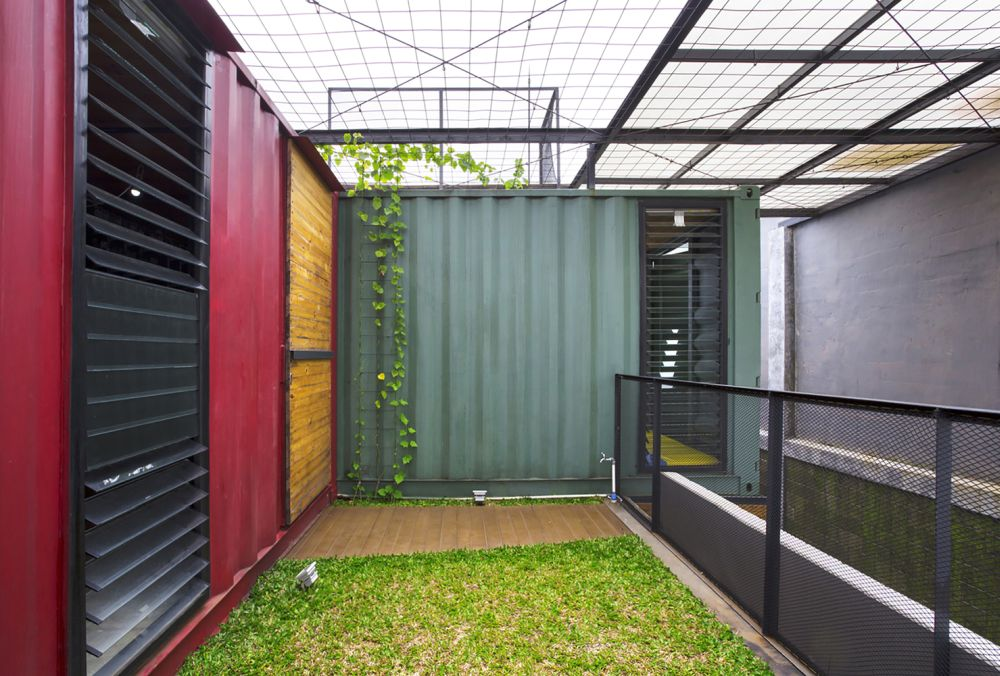 Indonesia Container for Urban Living Atelier Riri exposed walls - Industrial Family Home Made From Shipping Containers And Reclaimed Pallets