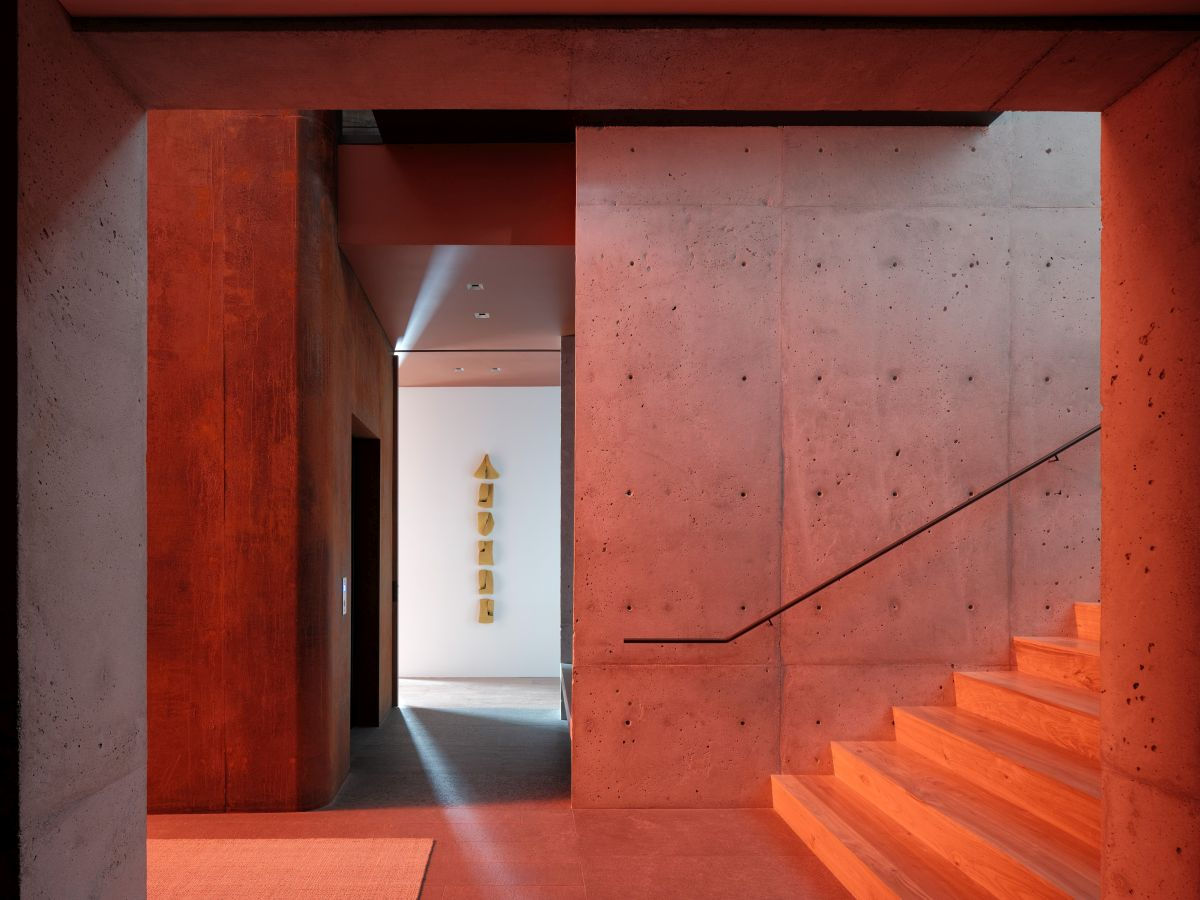 The colored windows also bathe the staircase is warm light and add a lot of character to the interior as a whole