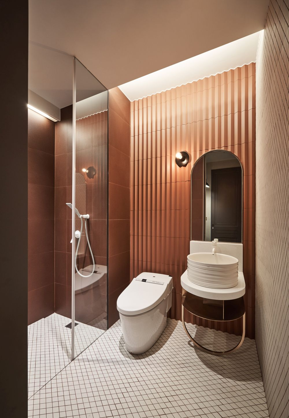 The bathroom has these chic copper accents that we also saw in the kitchen