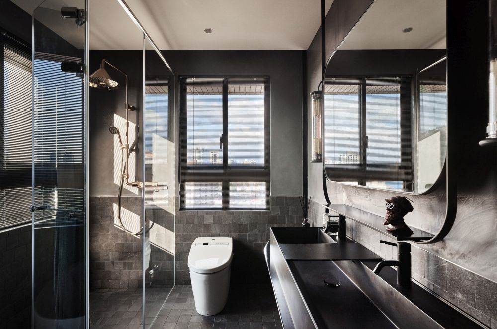 The master bathroom has a more masculine design, with lots of gray and neutral accents
