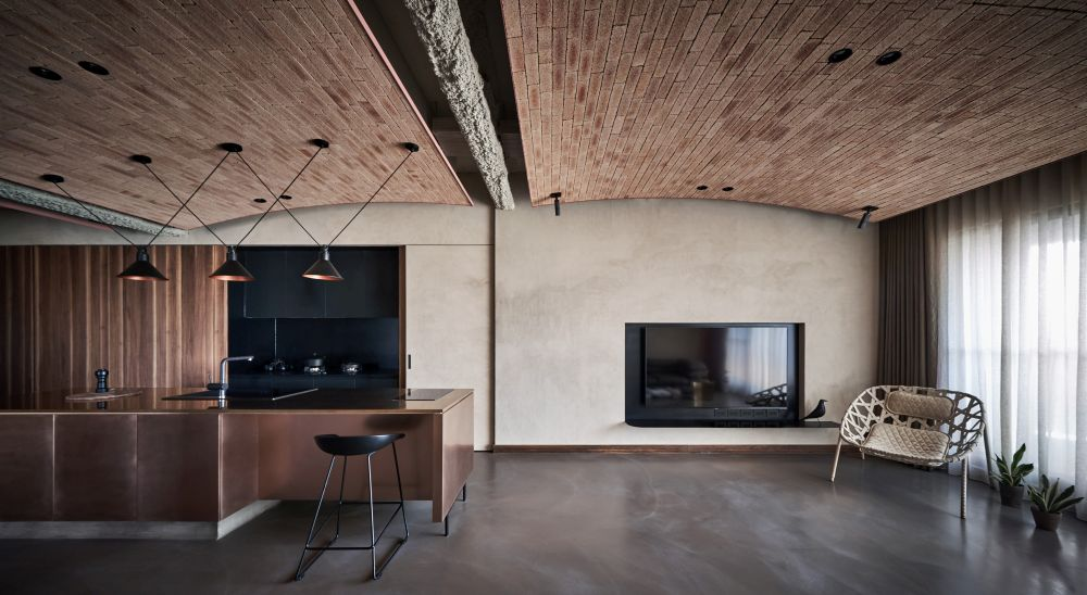 The living room, kitchen and dining area are consolidated into a single large space