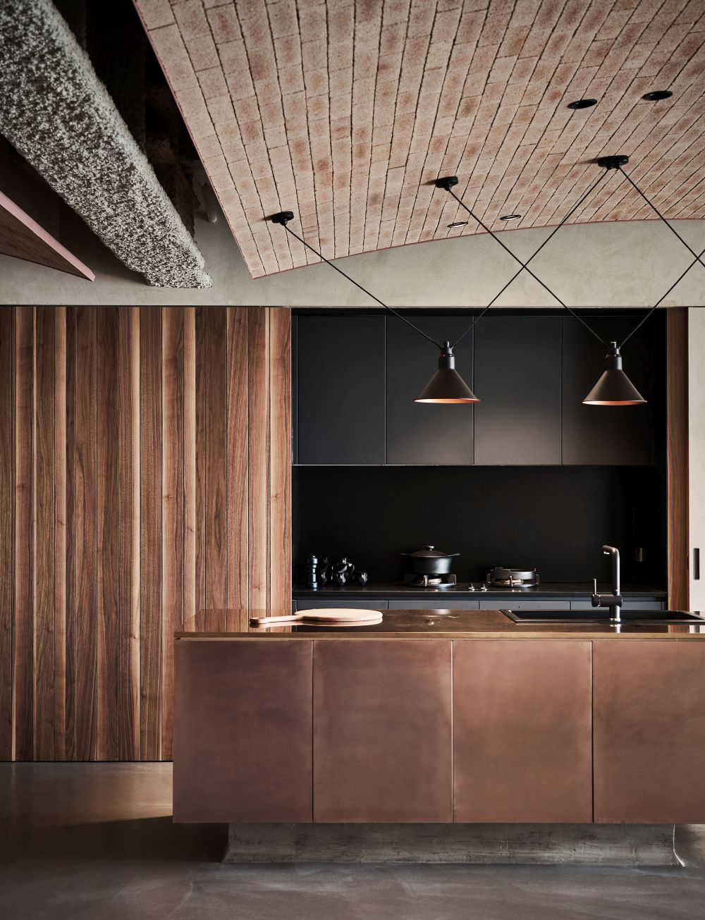 The materials and finishes used for the interior have a masculine and industrial vibe