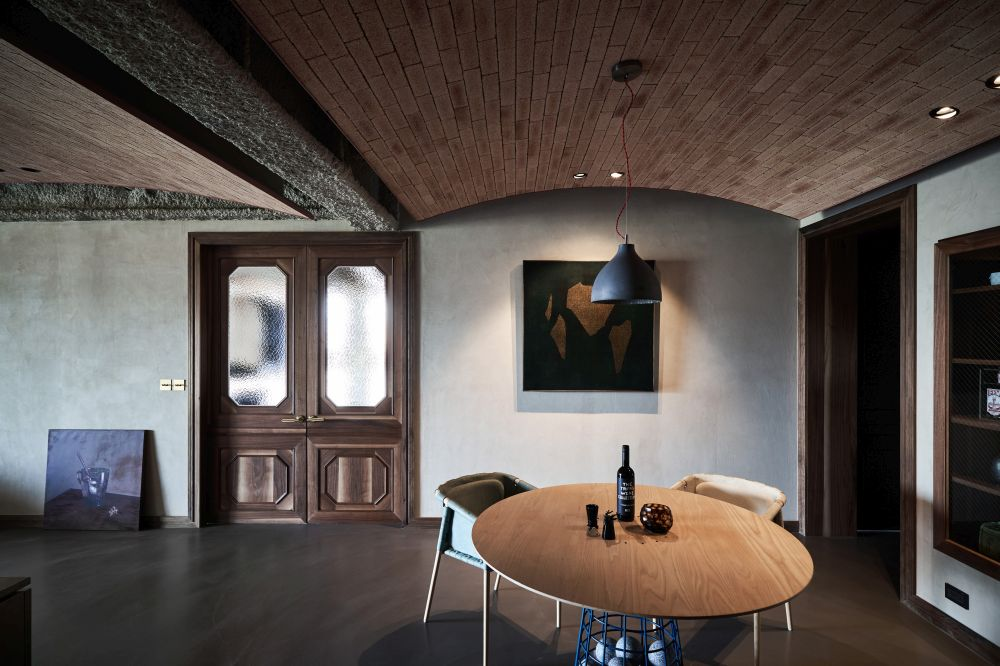 Each arched ceiling section marks a different function within this open plan space