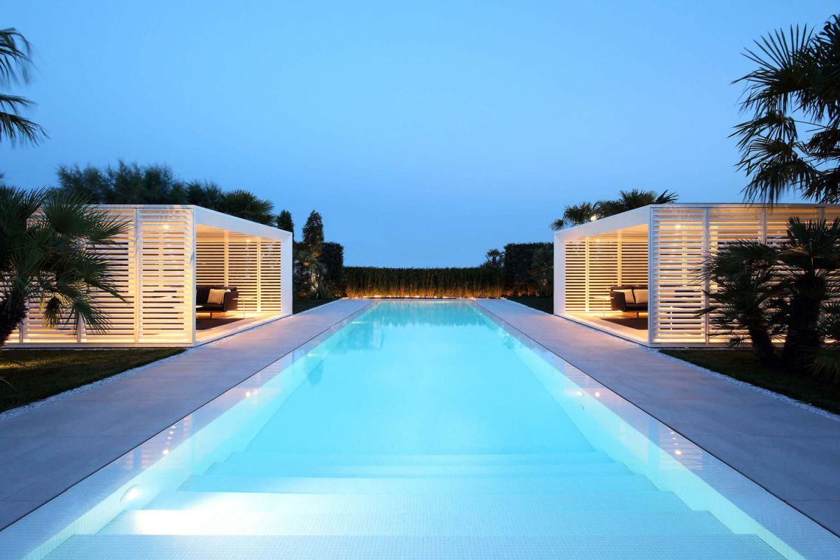 The 16 meter swimming pool divides the backyard in two and is shared between the owners