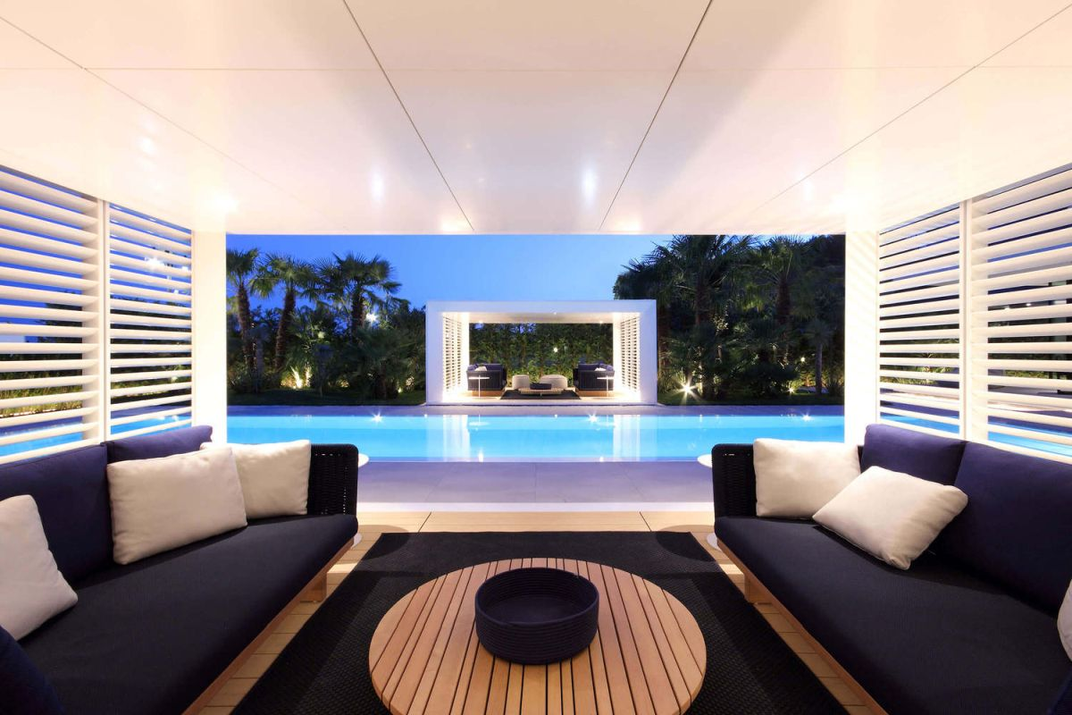 The poolside pavilions are furnished with stylish and comfortable sofas and a coffee table at the center