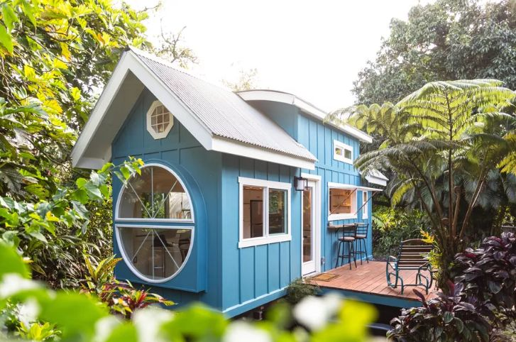 Tiny House With A Big Round Window And Tons Of Character