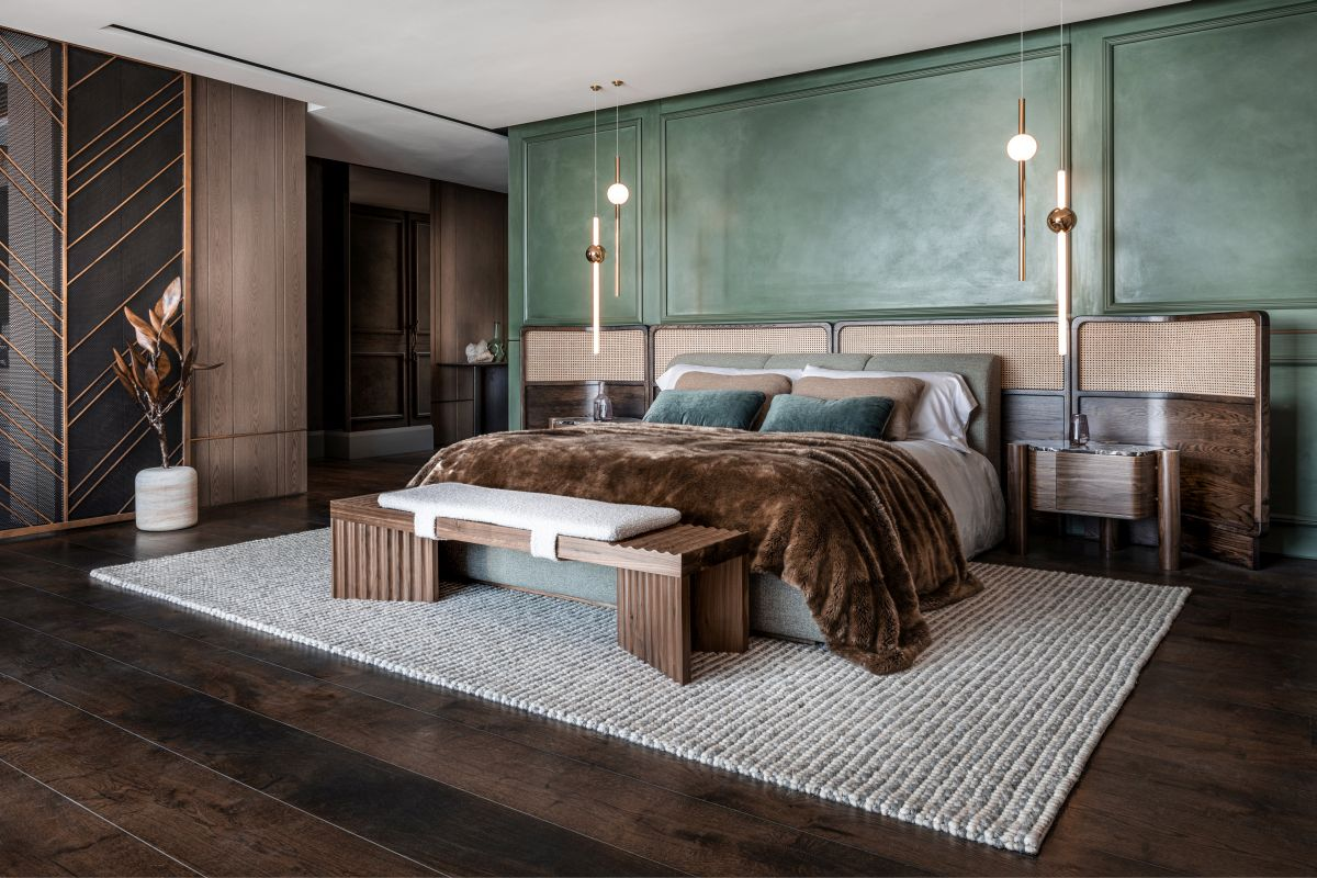 The master bedroom is large and spacious and features a green accent wall