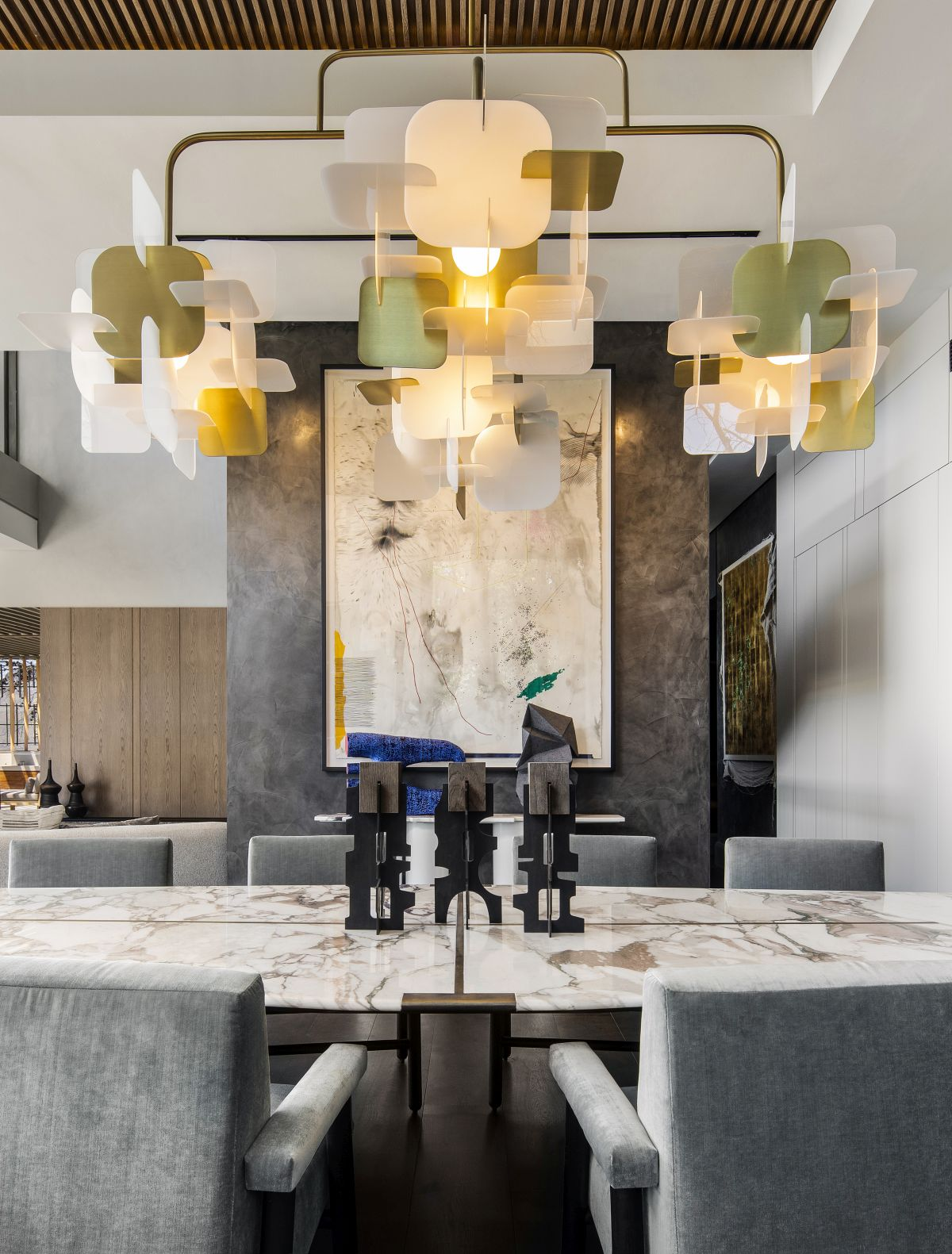 The dining table is one of several custom furniture pieces featured throughout the penthouse