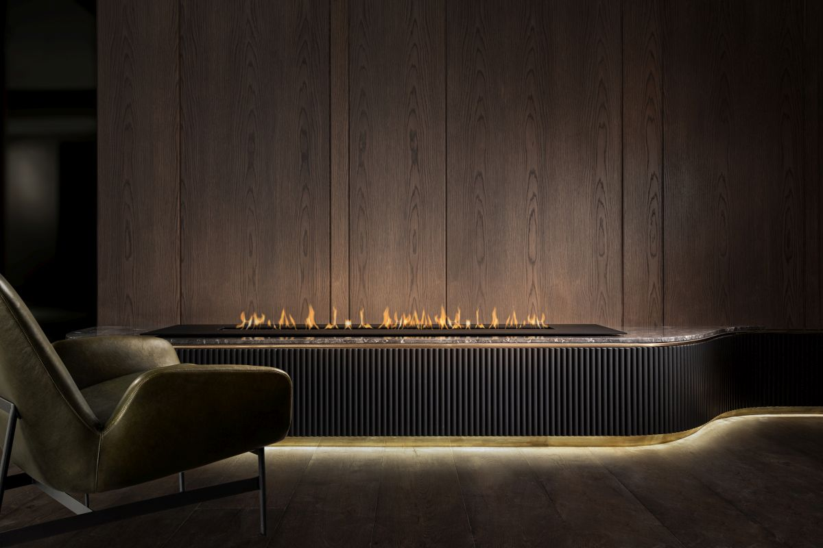 A contemporary fireplace highlighted by subtle LED lighting serves as a soothing focal point