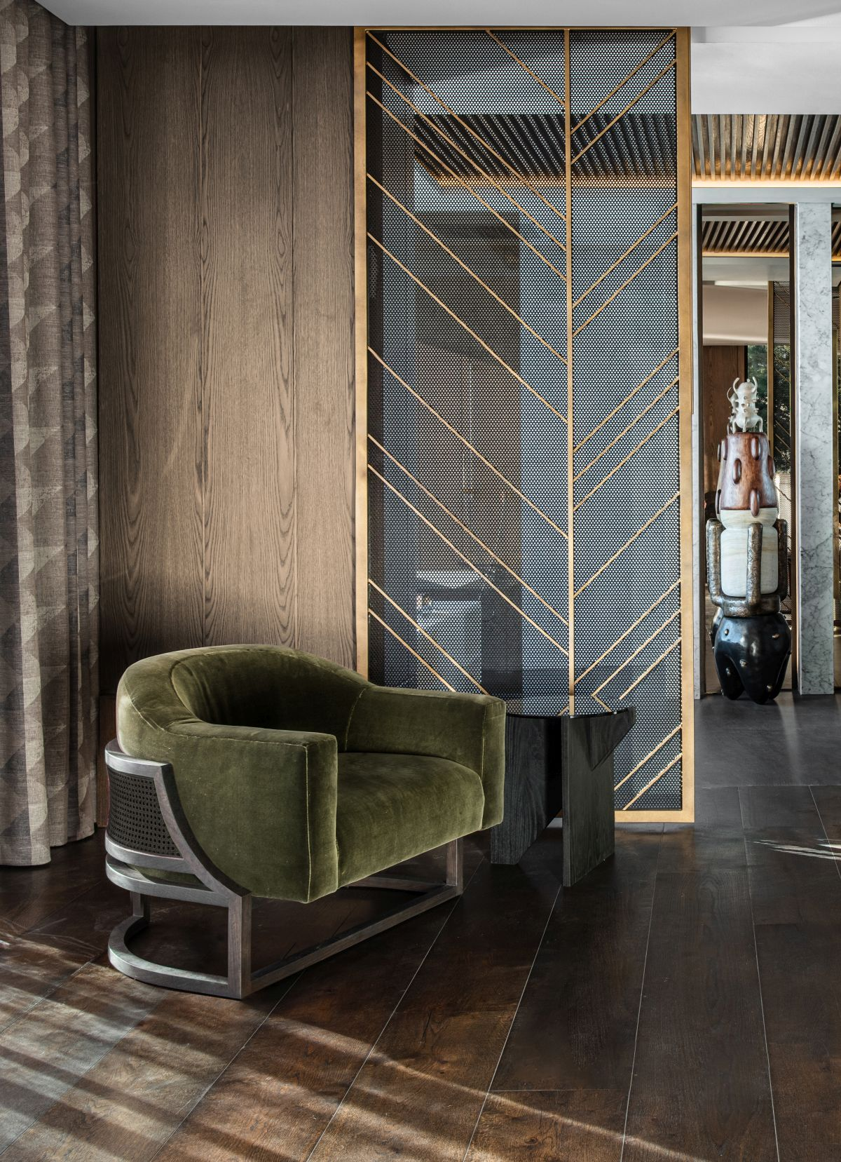 Dark and faded shades of green are also featured in other forms throughout the interior