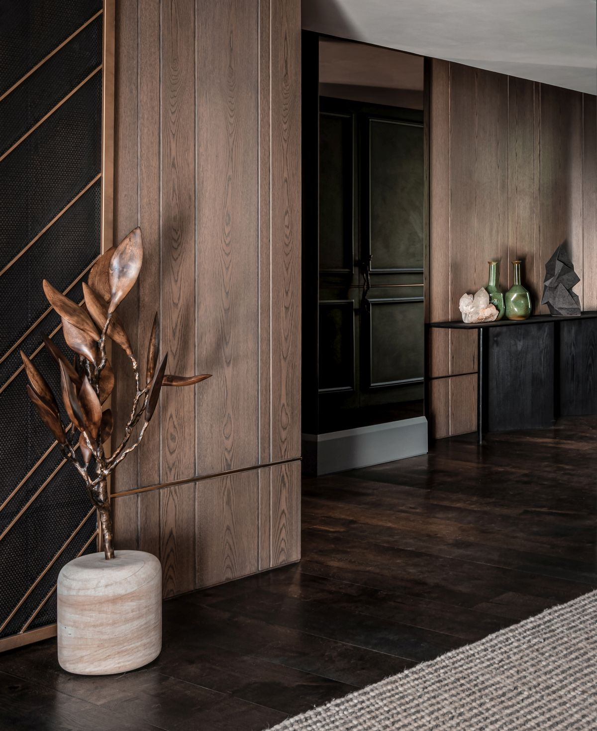 Beautiful natural wood is used extensively throughout the interior in combination with refined accent materials