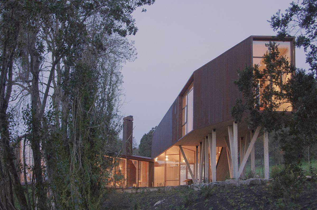 In an unusual way, the corten steel exterior actually helps to make the house look more organic