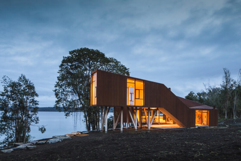 Corten Steel Family House On The Steep Bank Of A Beautiful Lake