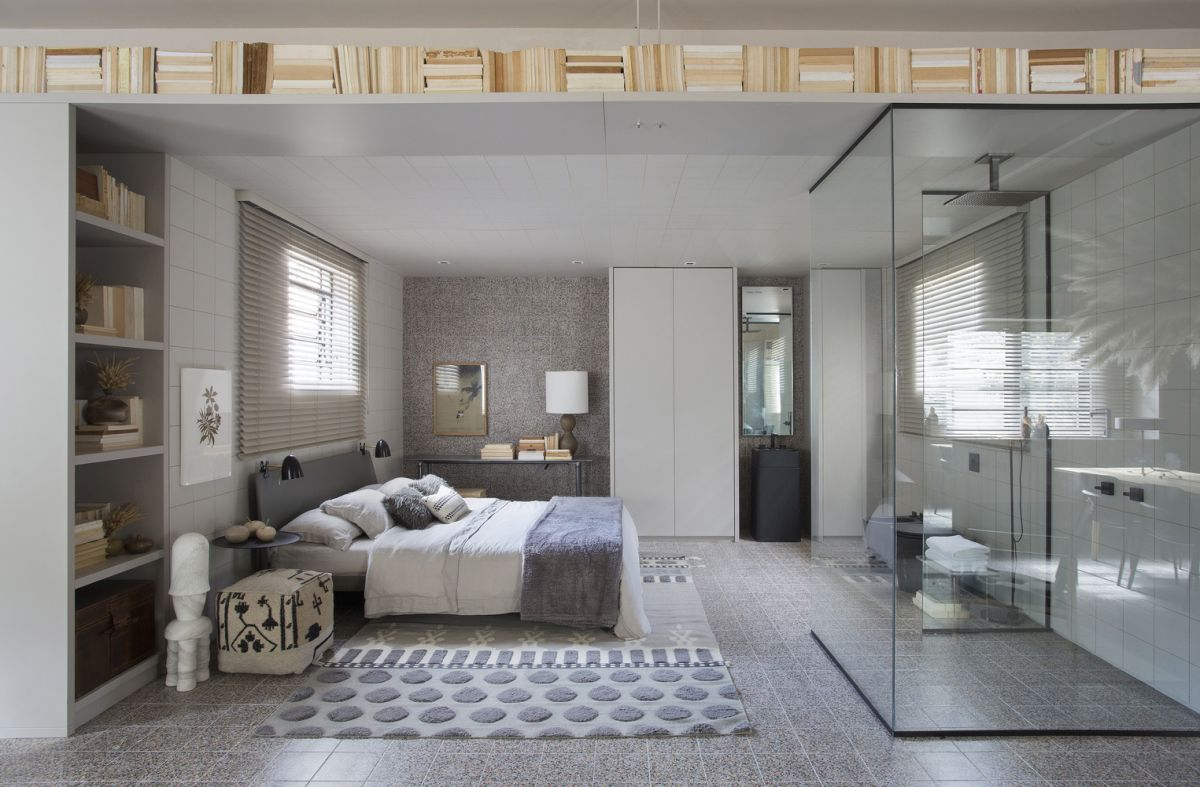 The bedroom and related functions occupy one side of the house and are seamlessly combined into a single open space