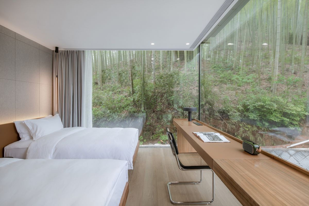 The bedrooms enjoy a simple interior design with minimal furnishings, allowing the emphasis to be on the views