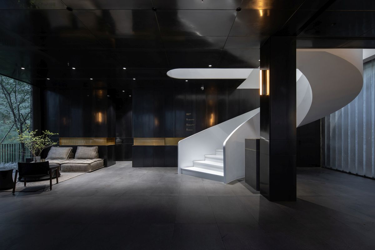A graceful white staircase spirals up and leads to the other floors that contain the guest rooms