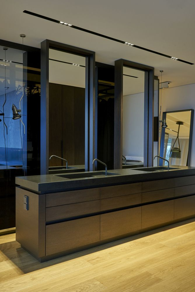 Large mirrors give the bathrooms an airy and spacious look