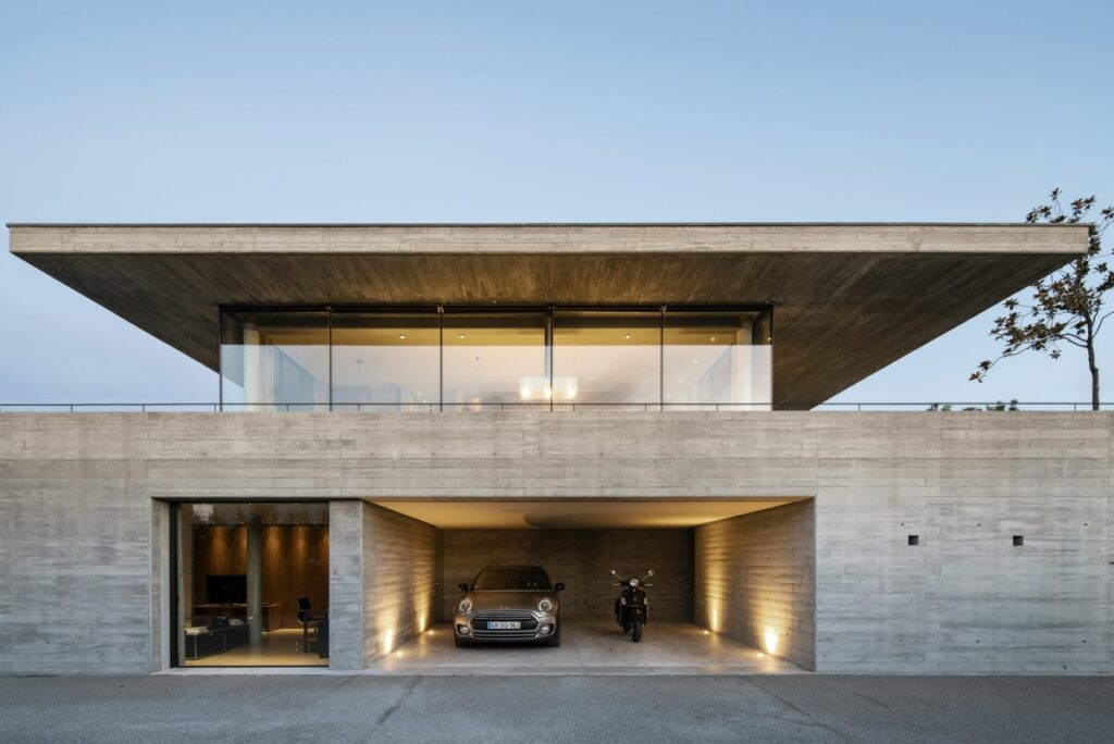 The simple gray exterior gives the house a modern look and allows it to blend into the surroundings