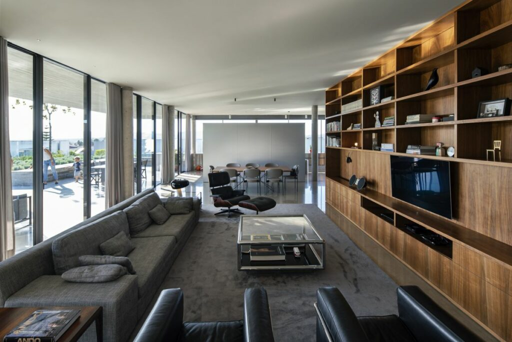 The elongated floor plan creates a warm and cozy ambiance in the main living area