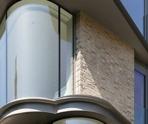 Contemporary Apartment Block In London With Bow Windows and Brick Facades
