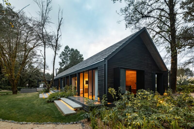 A Long and Narrow Cabin House With A Beautiful Burnt Wood Exterior