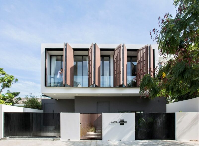Modern Feng Shui House With Big Wooden Shutters
