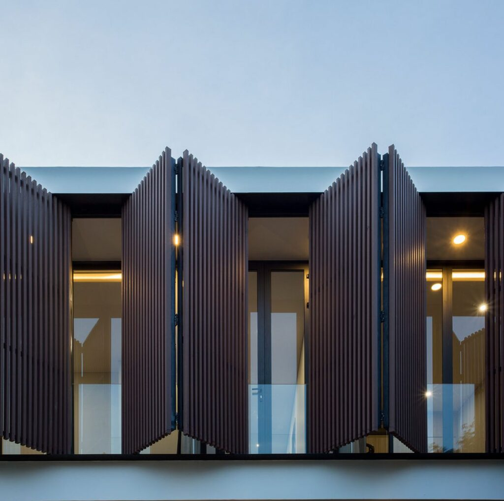 The folding shutters on the upper floor are both practical and decorative