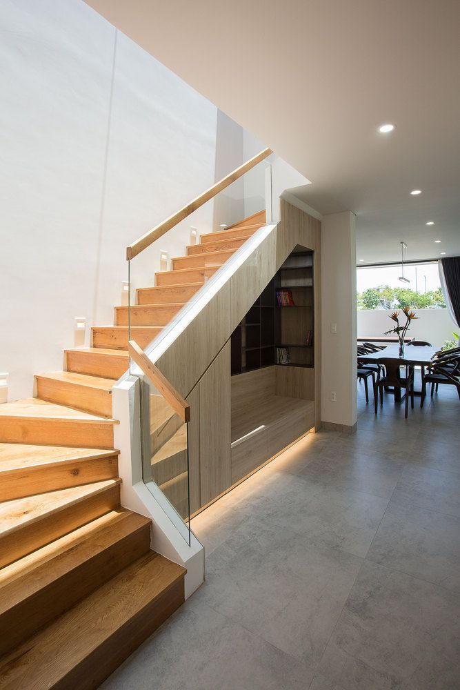 The front entrance leads into the staircase lobby which has a space-saving storage space under the stairs