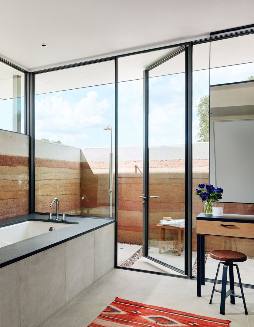 The bathroom is very bright and open and has access to an outdoor shower enclosure