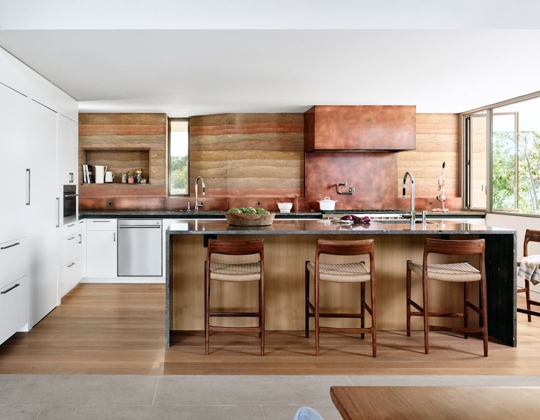 The kitchen accent wall with all the different layers of colors looks very organic and beautiful