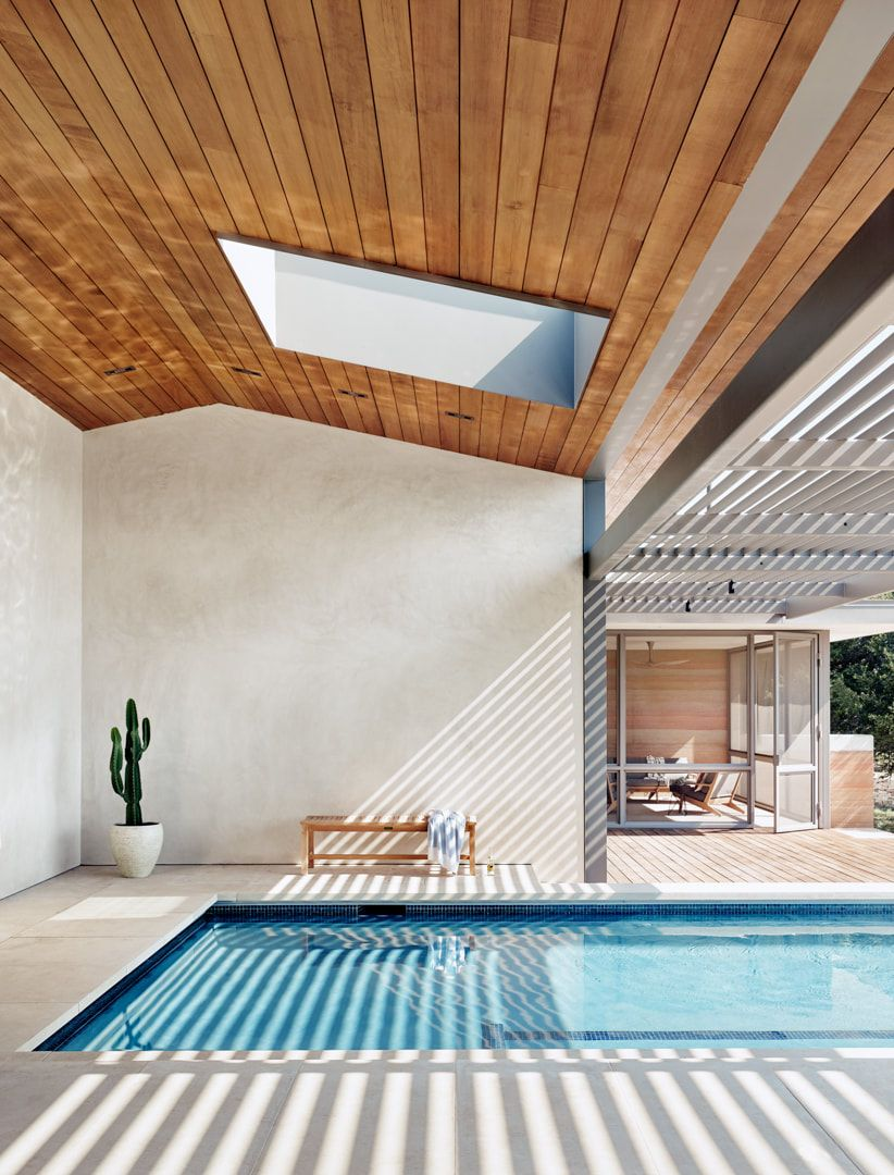 One end of the swimming pool penetrates the deck and is protected by the roof