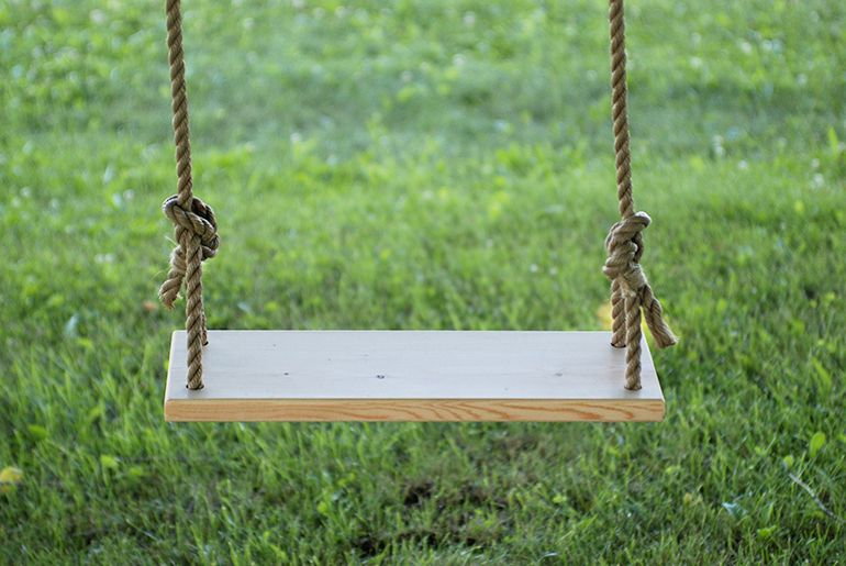 Simple swing hanging from a tree branch