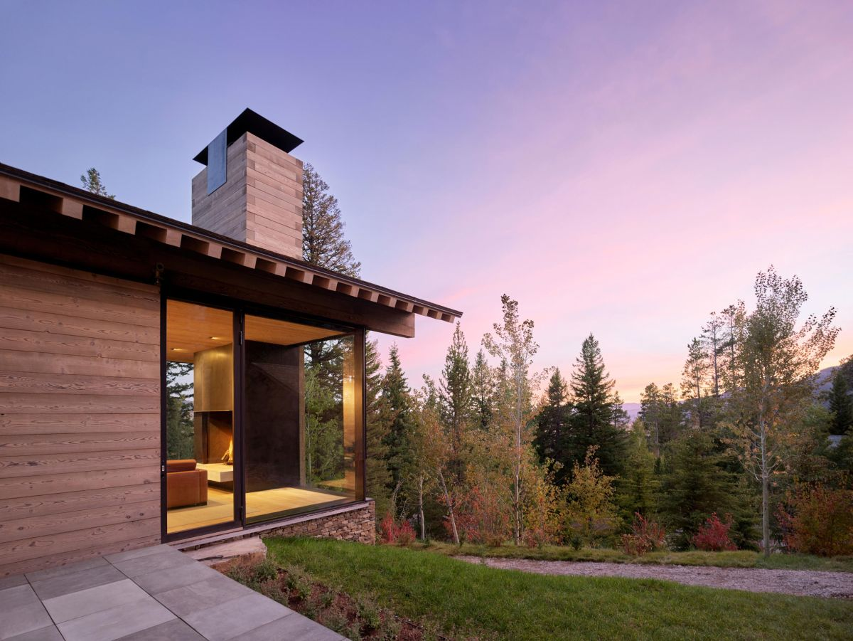 A Mountain Retreat With Big Wooden Shutters And A Pulley System To Operate Them With