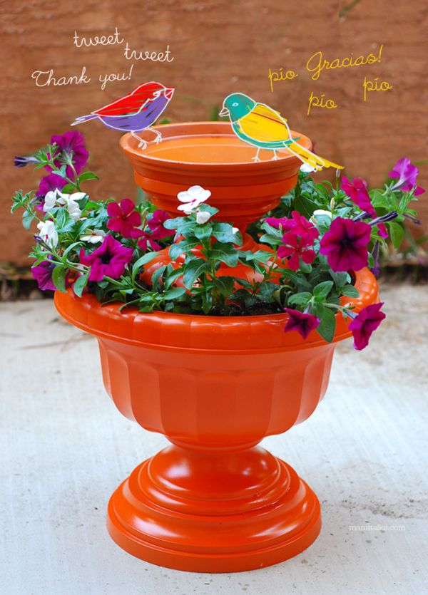 A cute bird bath made of planters