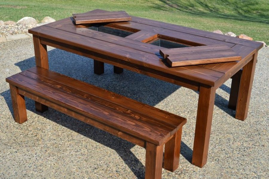 An outdoor table with built-in ice boxes