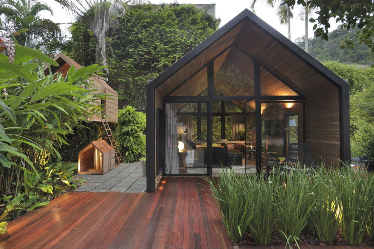 The optional treehouse and pet house are designed in the same style as the main building
