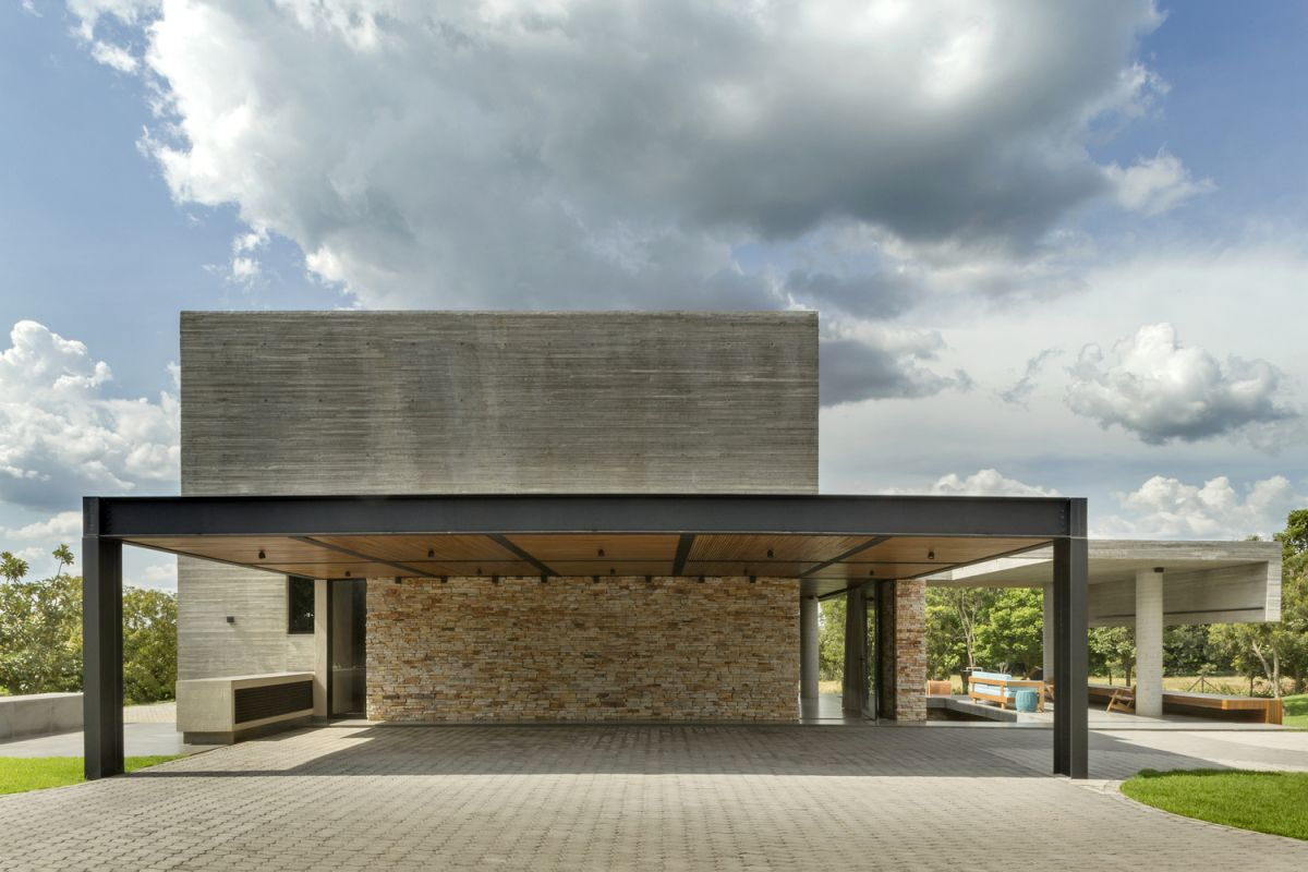 There's also a spacious covered parking space at the rear of the house, connected to a stone wall