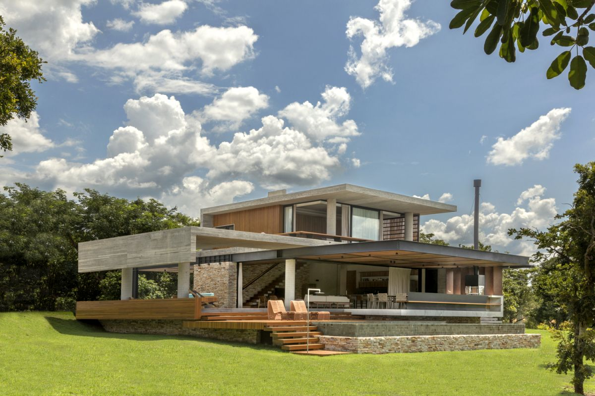 The house is built from simple materials such as concrete, stone, steel, wood and glass