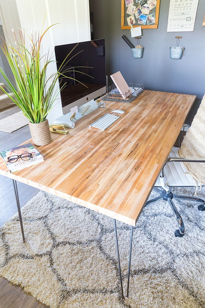 Minimalist desk with a wooden top and hairpin legs