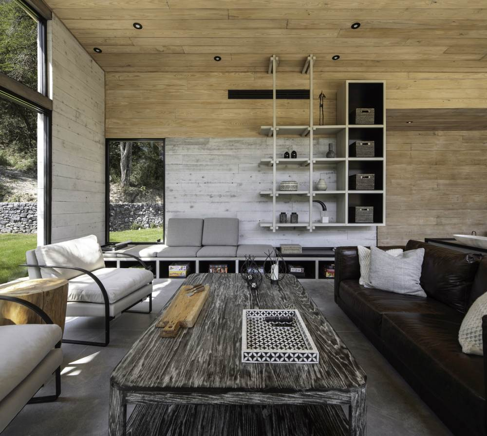 Custom furniture adds character to each space, reinforcing the connection between the cabin and nature