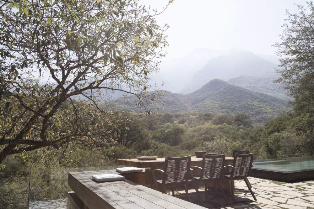 The terrace and swimming pool overlook the valley and the distant mountains