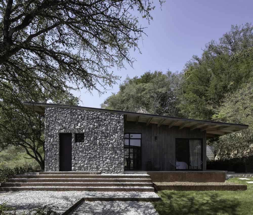 Natural stone and wood were used to help the cabin blend into the landscape