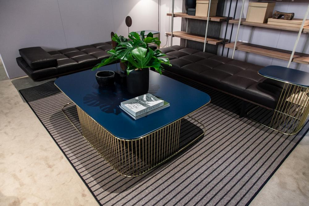The matching tables combined with the leather padded benches give this area a chic and modern look