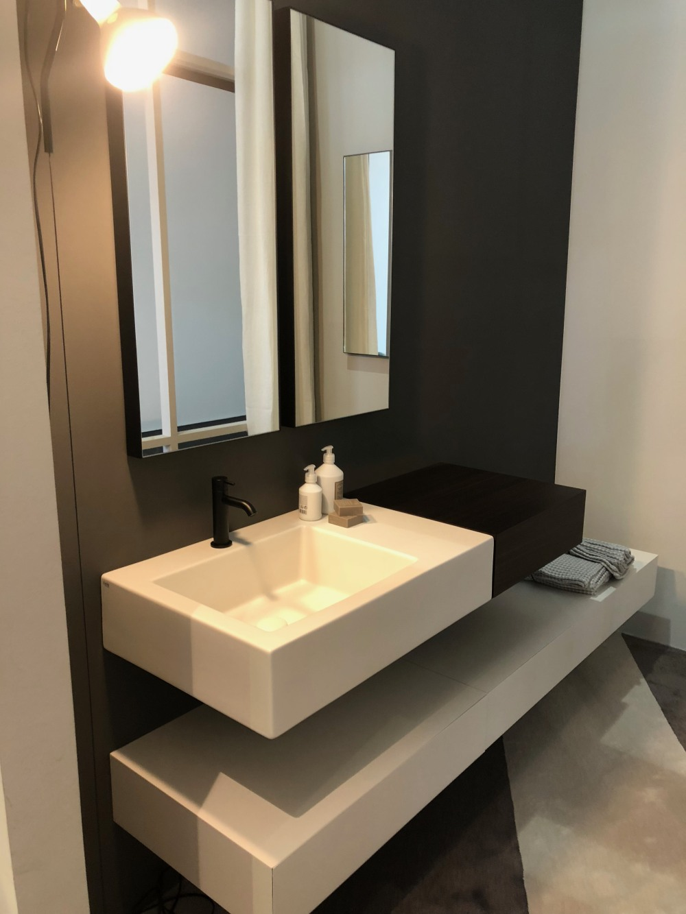 Although very simple, the design of this bathroom vanity very effectively conceals the plumbing and offers generous storage